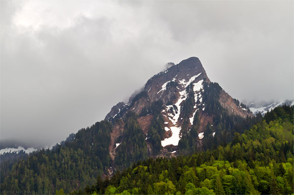 ridge on mount cheam shows through the clouds near popkum in british columbia canada