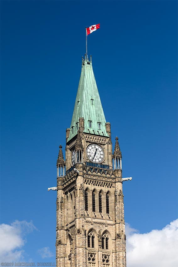 flag on peace tower at parliament buildings in ottawa canada
