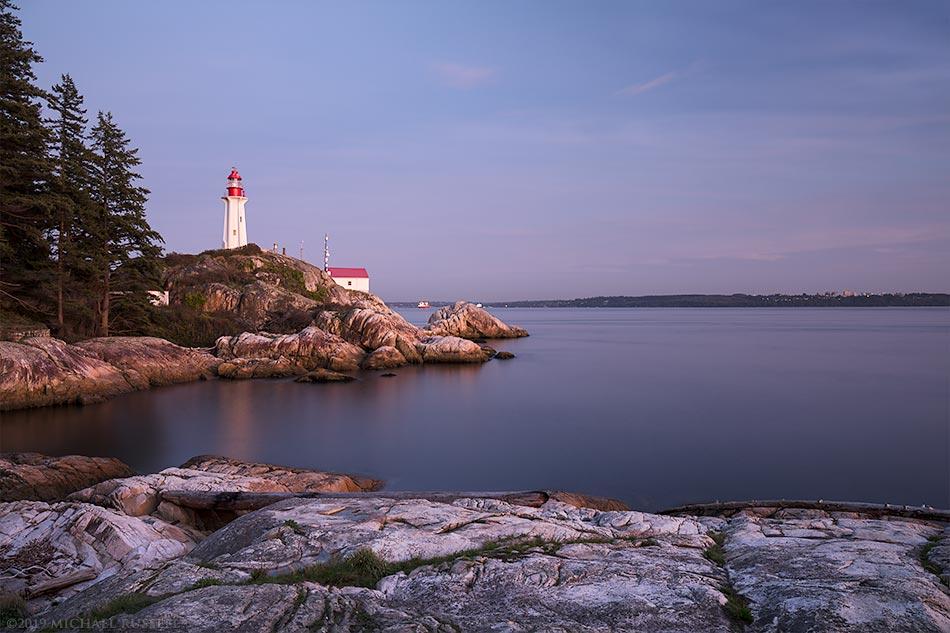 point atkinson lighthouse in lighthouse park after sunset