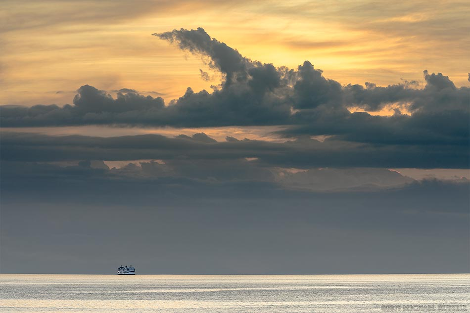 ferry sailing in the salish sea at sunset