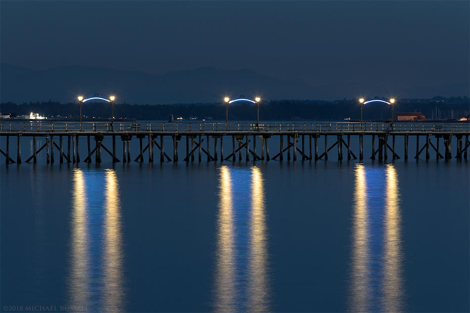 lights on the white rock pier at night
